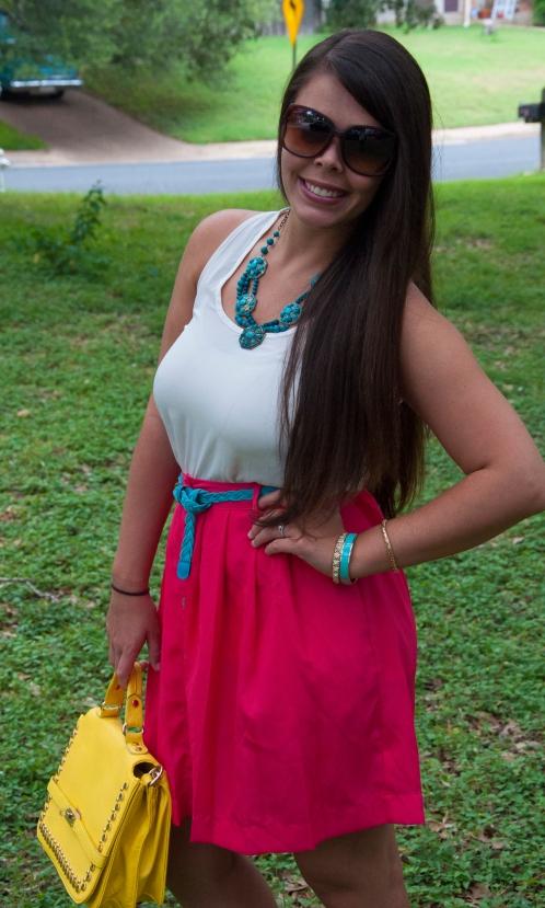 All That Glitters: Pink skirt, yellow handbag