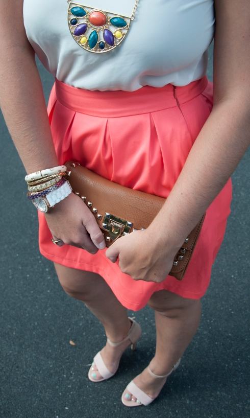 Coral skirt with cognac clutch