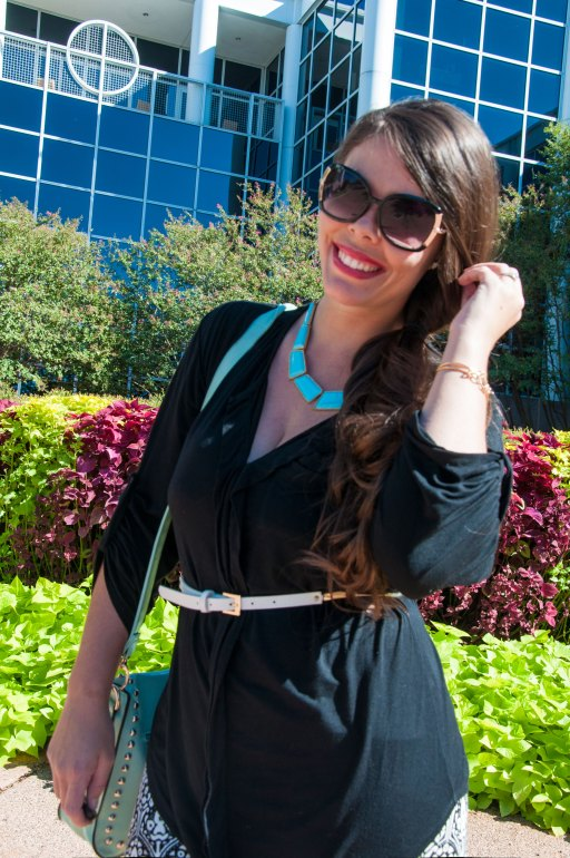 Black shirt and mint necklace